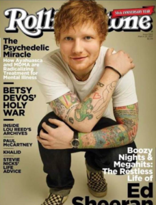 Cover image featuring Ed Sheeran squatting down with his arms wrapped around his kneed and shoulder. Cover story is for The Psychedelic Miracle.